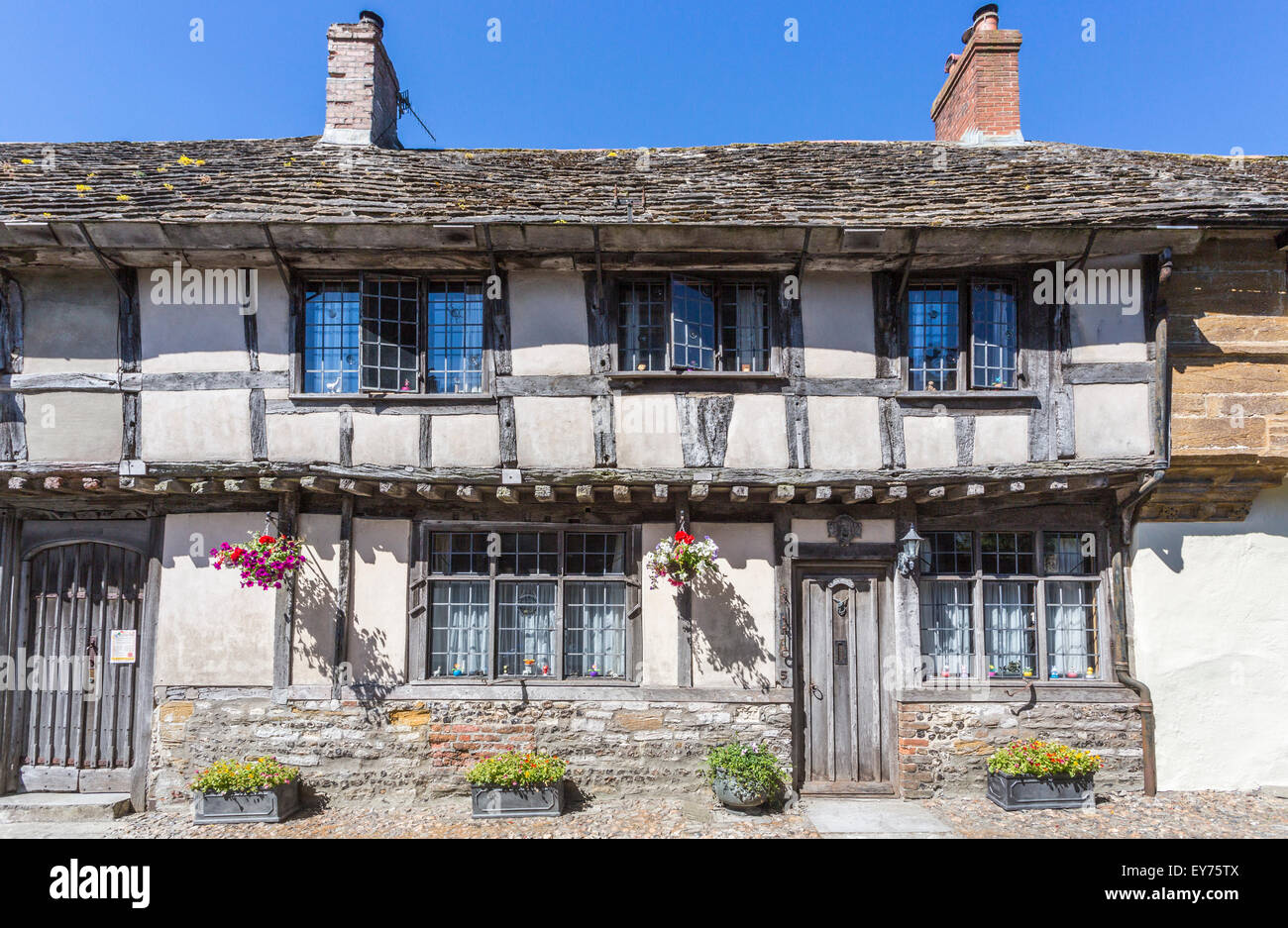 Old traditional timbered cottages with slate tiled roof in Cerne Abbas, a village in Dorset, south-west England, - Stock Image