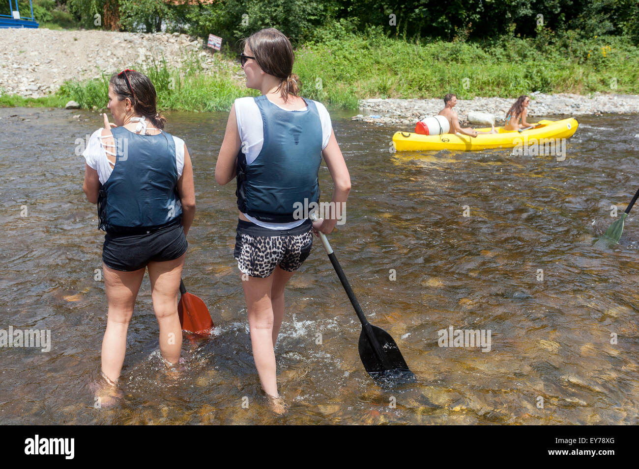People going down by the river Vltava, canoeing, two girls, South Bohemia, Czech Republic - Stock Image