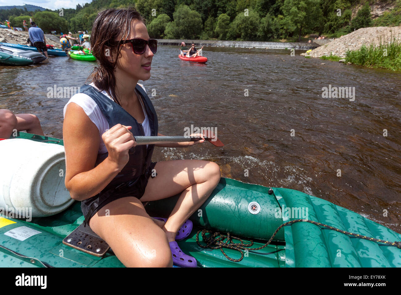 Going down by the river Vltava, girl rafting, South Bohemia, Czech Republic - Stock Image