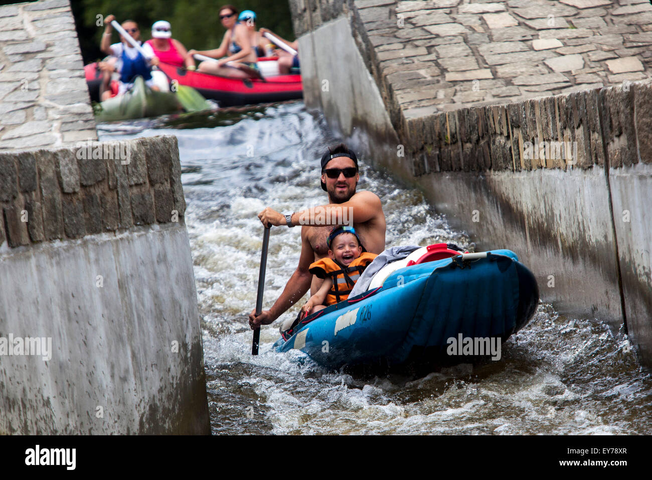 Father with son going down by the river Vltava, rafting, Zlata Koruna weir, South Bohemia, Czech Republic - Stock Image