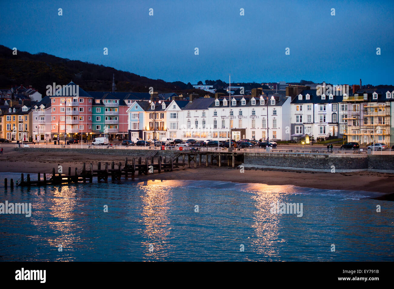 Seaside resort: The Belle Vue Hotel  and promenade at Aberystwyth in the evening, Wales UK - Stock Image