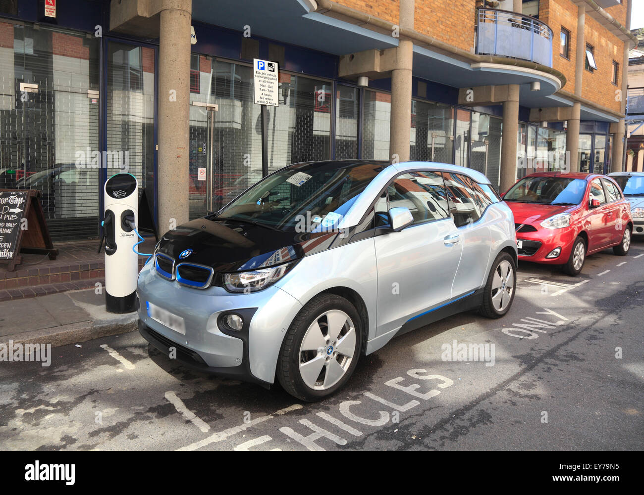 BMW Electric car recharging in the city of London - Stock Image