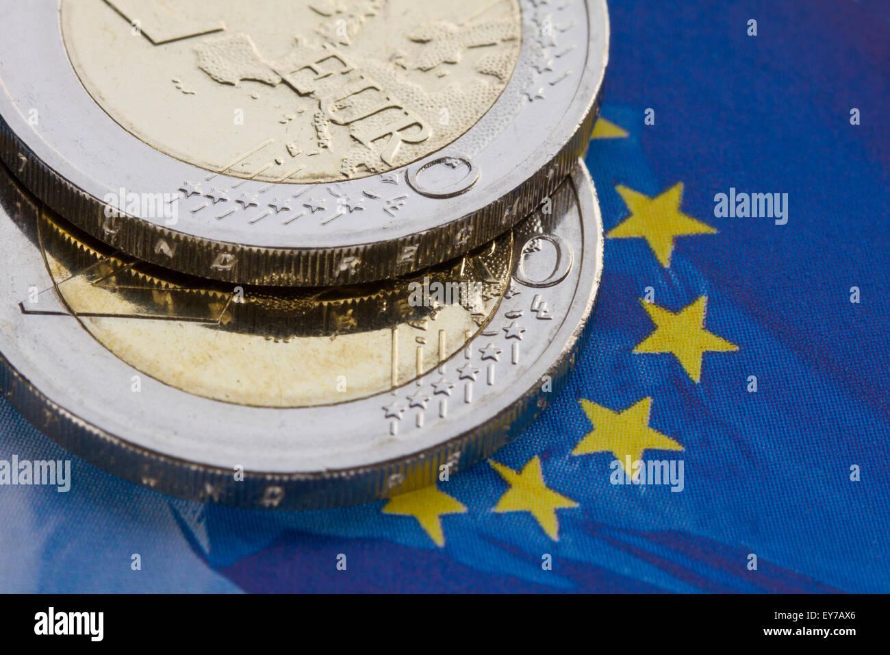 Euro coins on EU-flag - Stock Image
