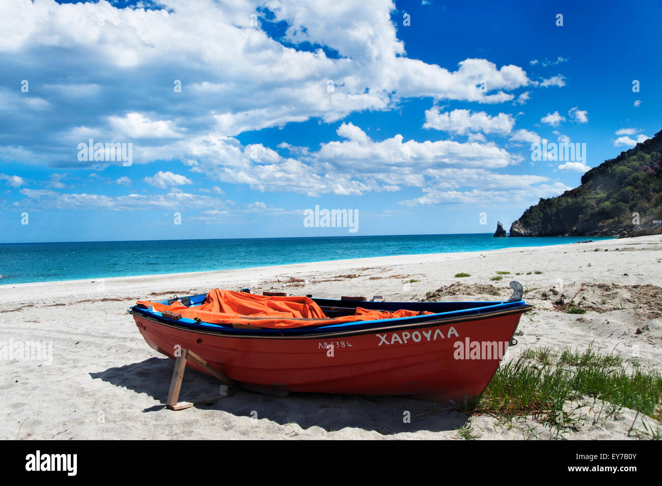 Boat lying on lonely beach on Pelion Peninsula, Thessaly, Greece Stock Photo