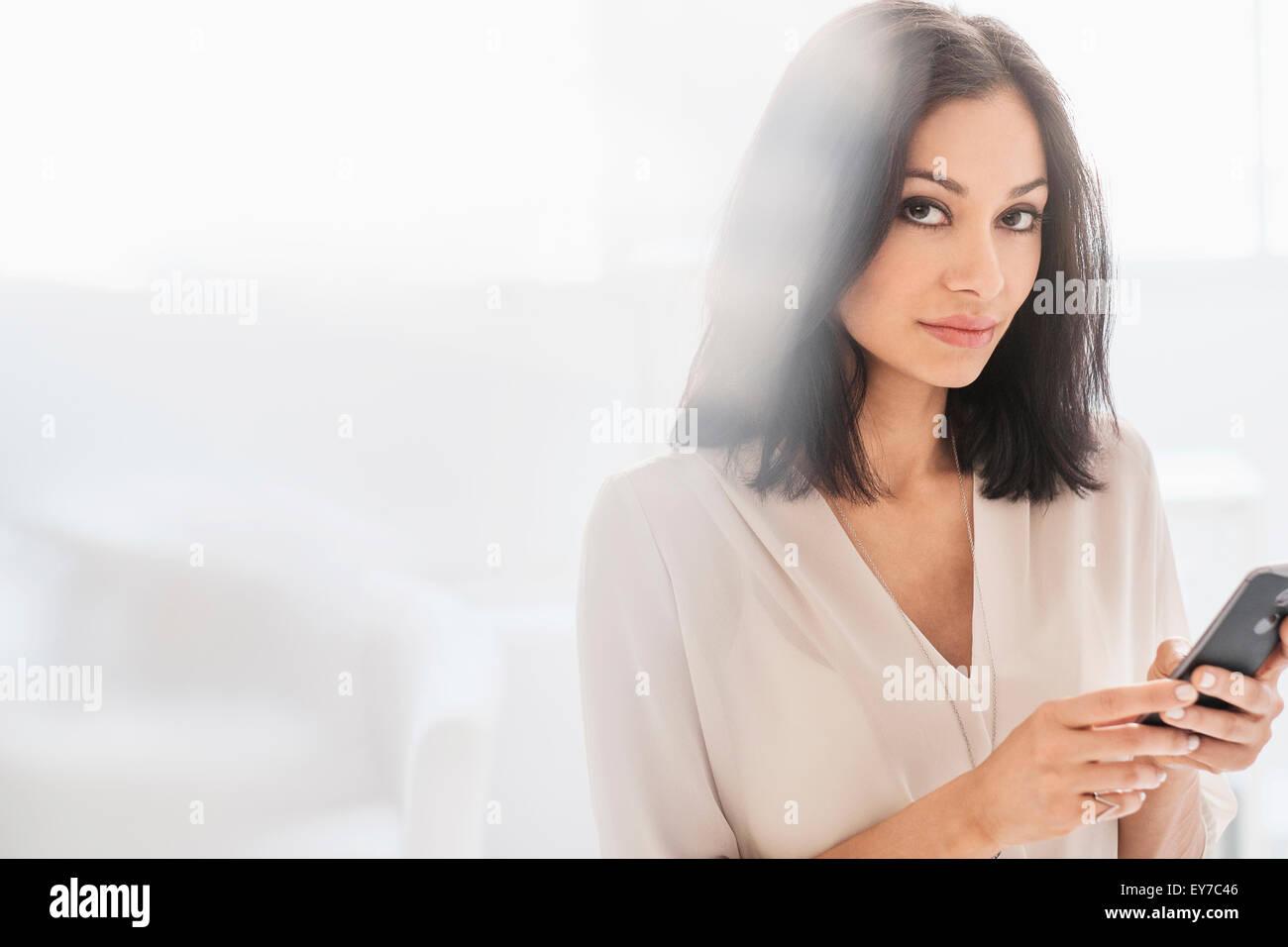 Woman using smart phone - Stock Image