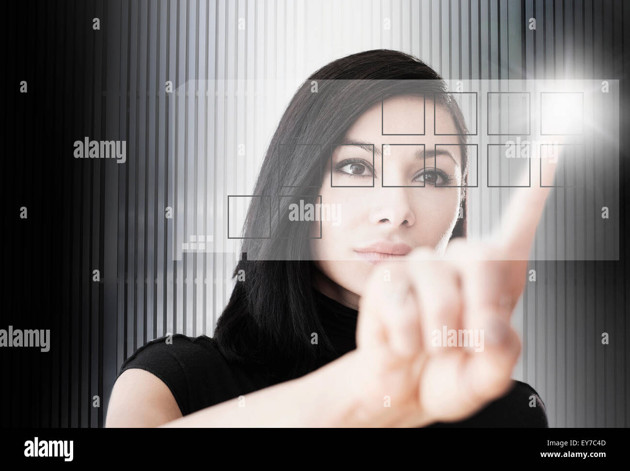 Woman touching screen button - Stock Image