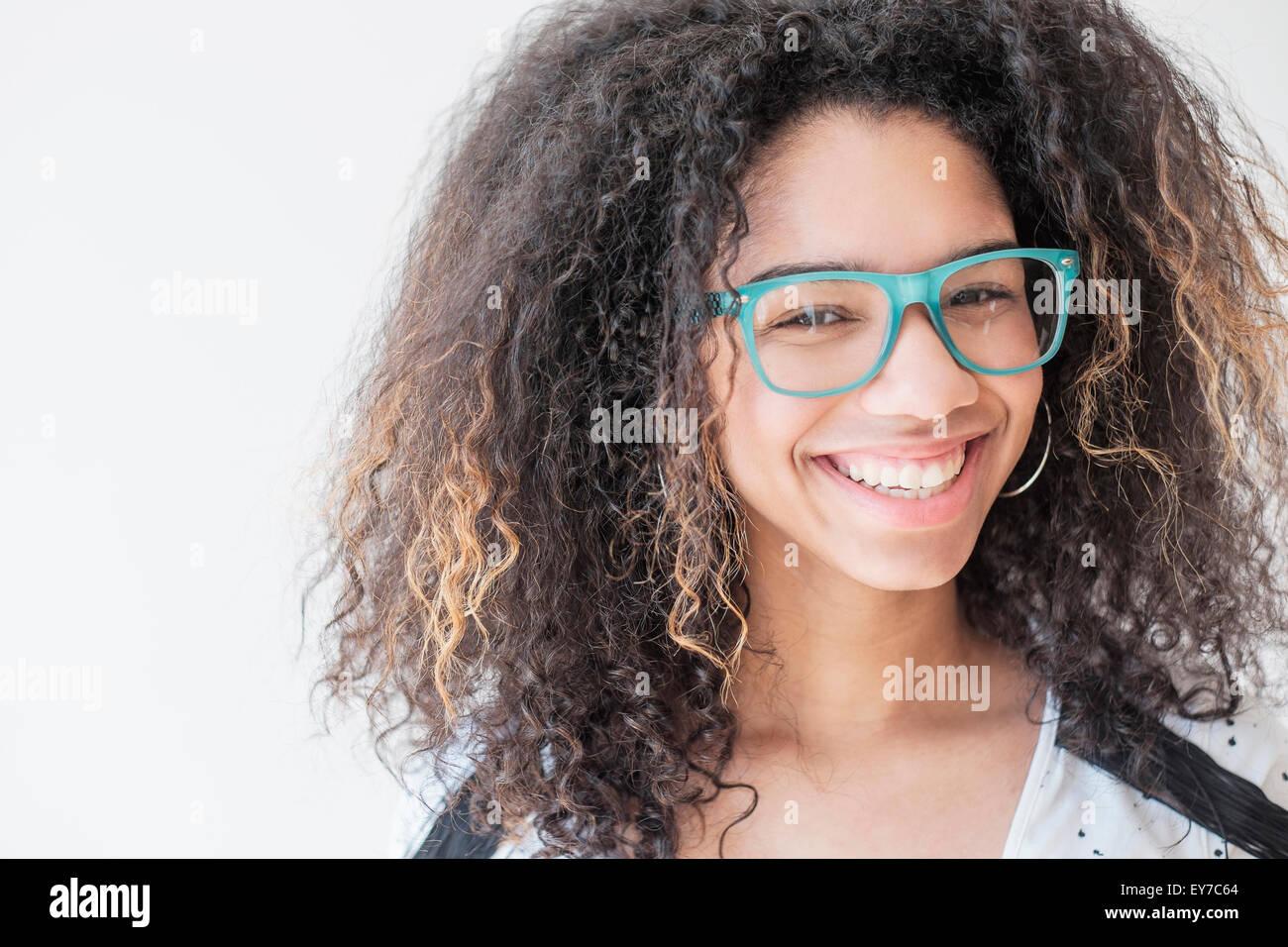 Portrait of teenage girl (16-17) wearing eyeglasses - Stock Image