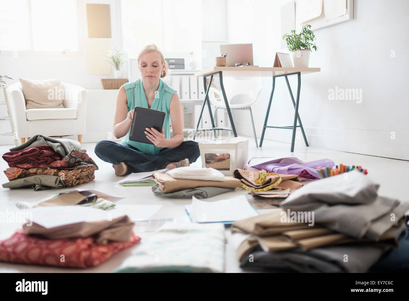 Design professional working in living room - Stock Image
