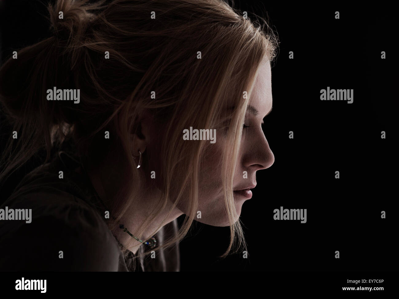 Portrait of blond woman in studio - Stock Image