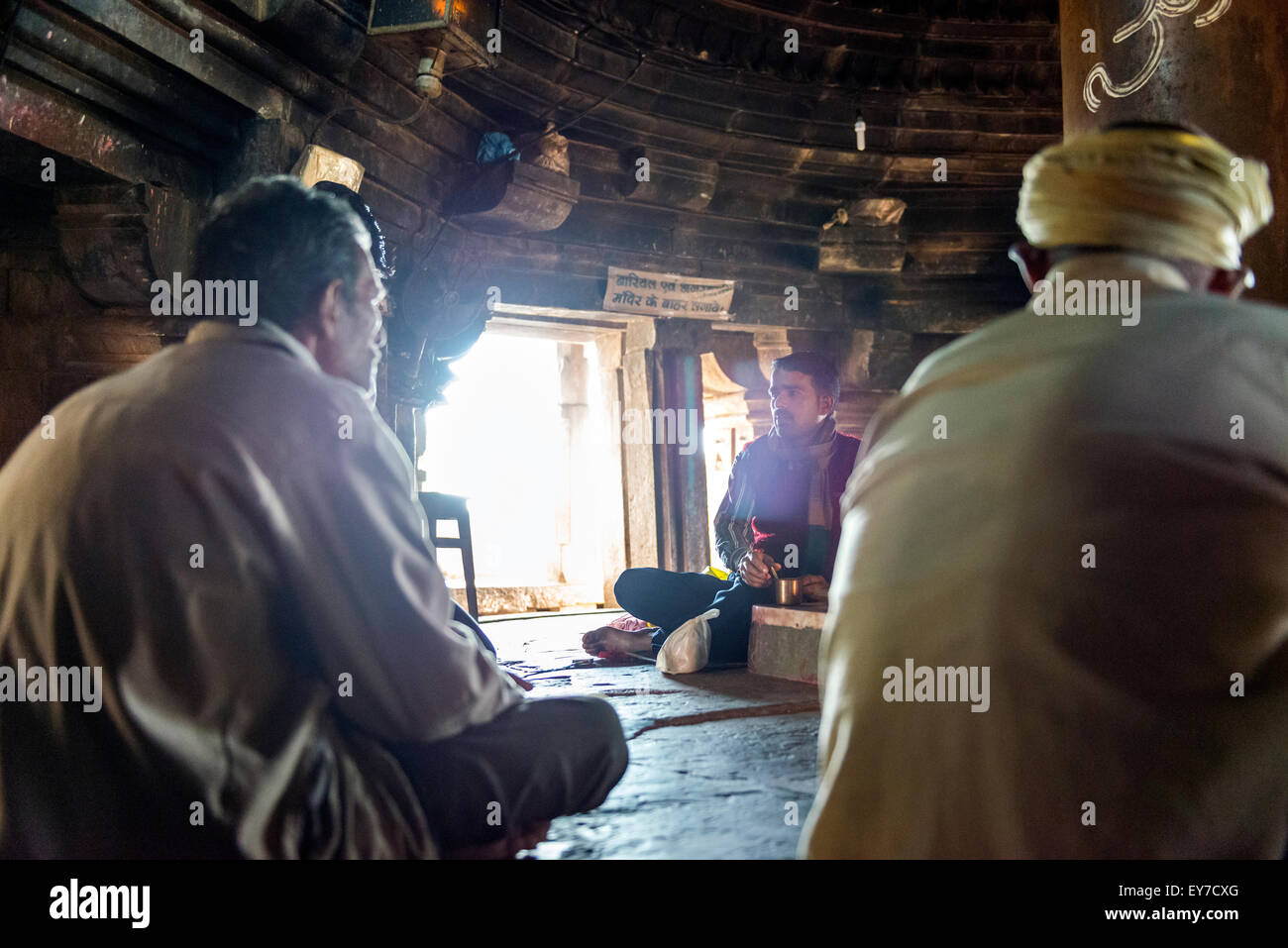 Religious rituals being performed inside a Hindu Temple in Khajuraho, Madhya Pradesh, India - Stock Image
