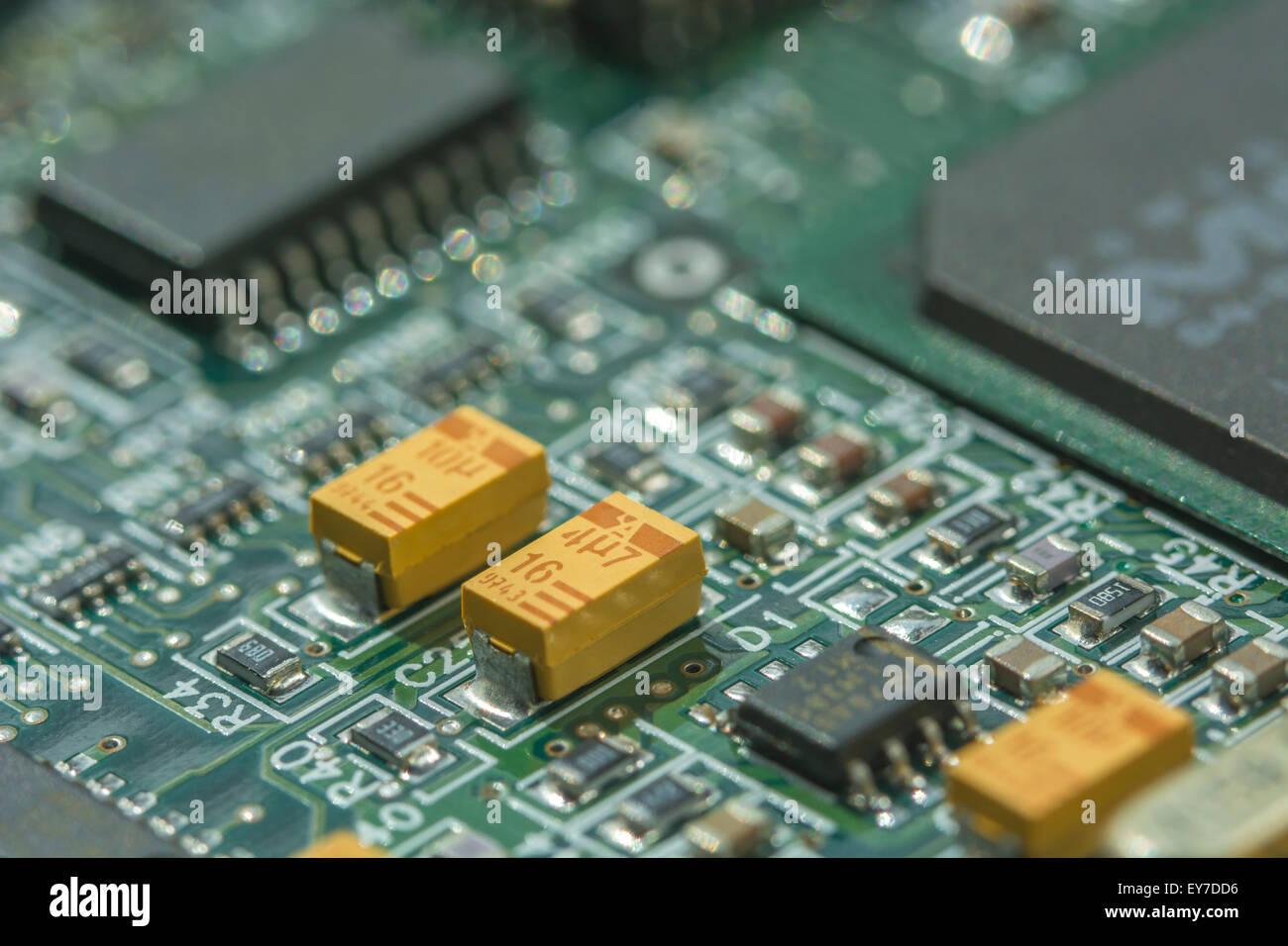 Macro Photo Of Printed Circuit Board Pcb Showing Yellow Tantalum Capacitors In Rare Element Oxide