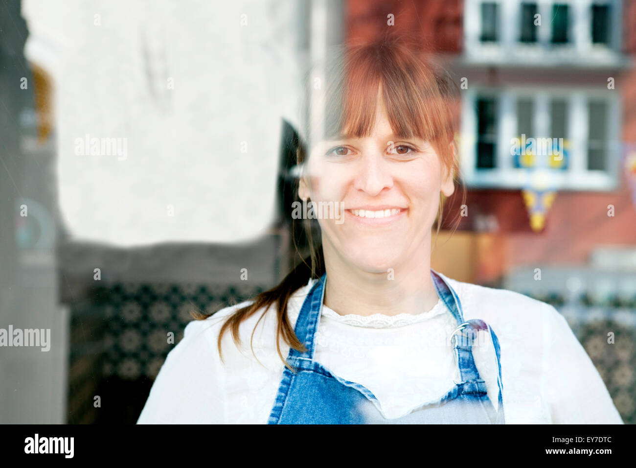 Female cafe owner, portrait - Stock Image