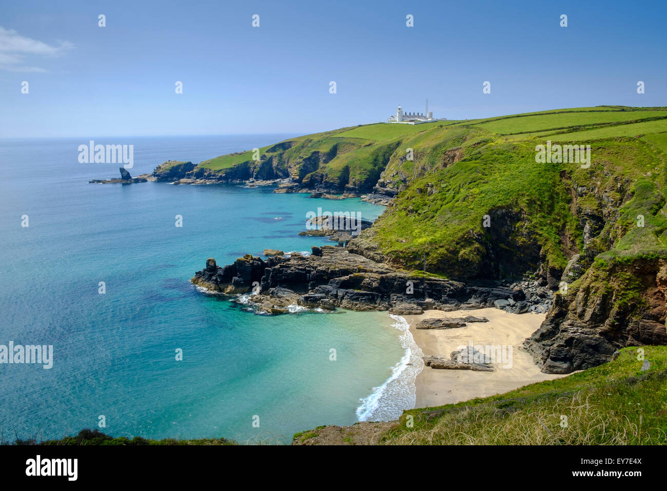 Cornwall coast landscape view of Lizard Point lighthouse, headland and Housel Bay cove beach, Lizard Peninsula, - Stock Image