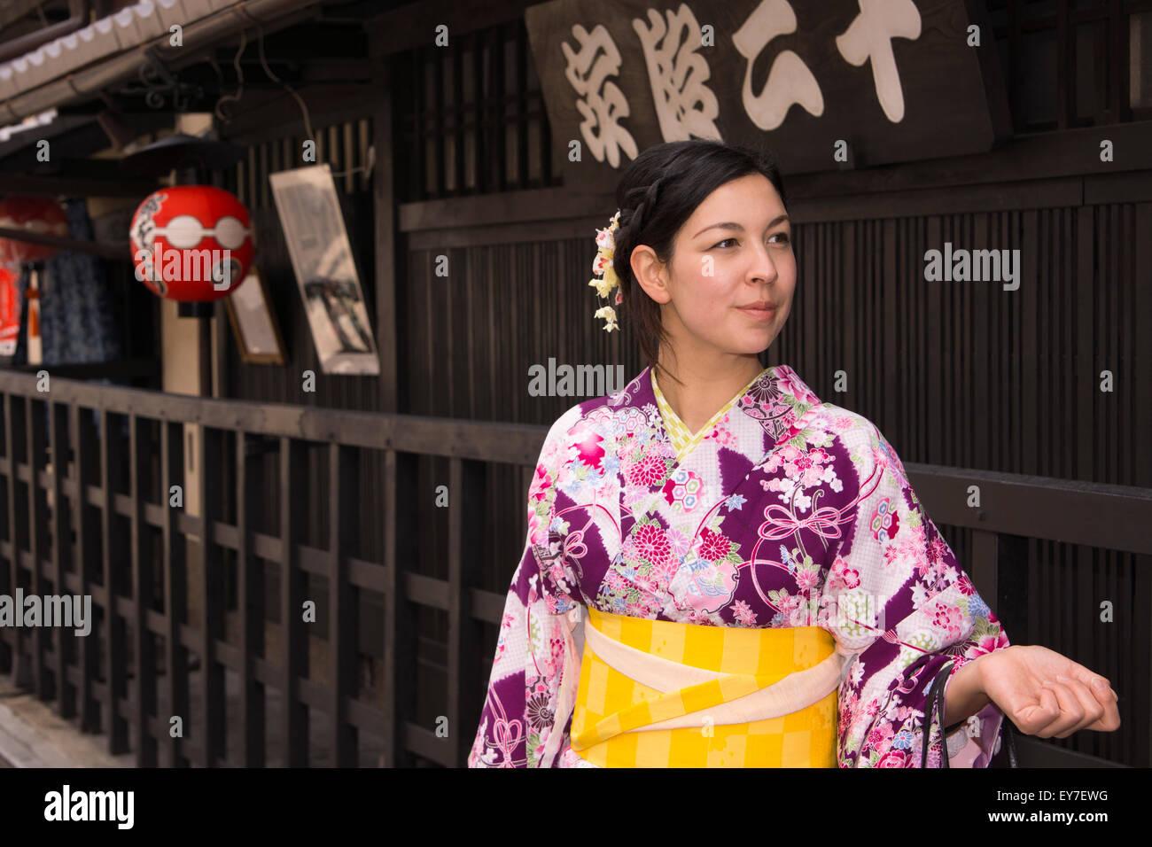 A young lady renting a kimono, enjoying walking around Gion, Kyoto. Stock Photo