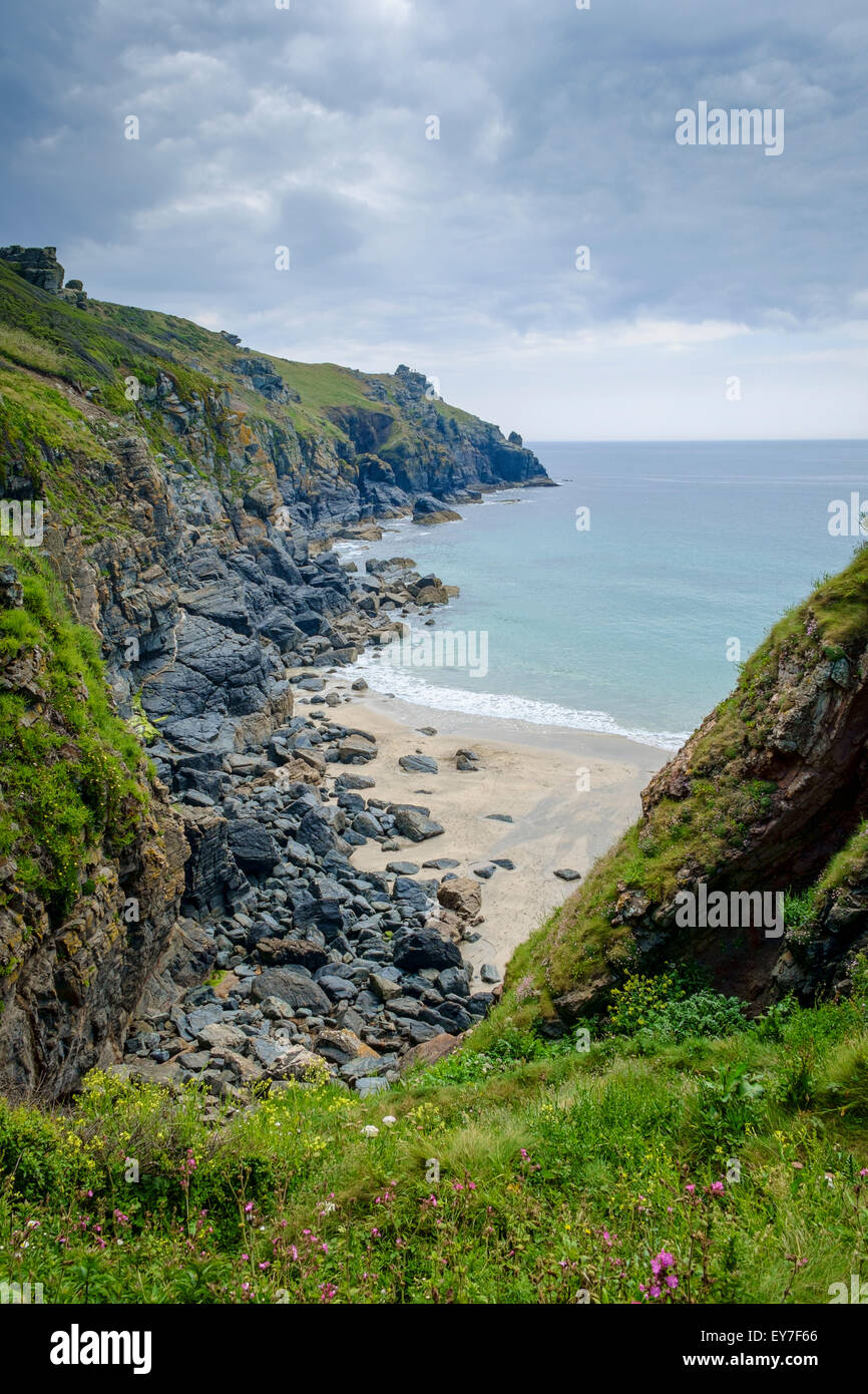 The beach in a hidden cove at Housel Bay, Cornwall, Lizard Peninsula, England, UK on the South West Coast Path - Stock Image