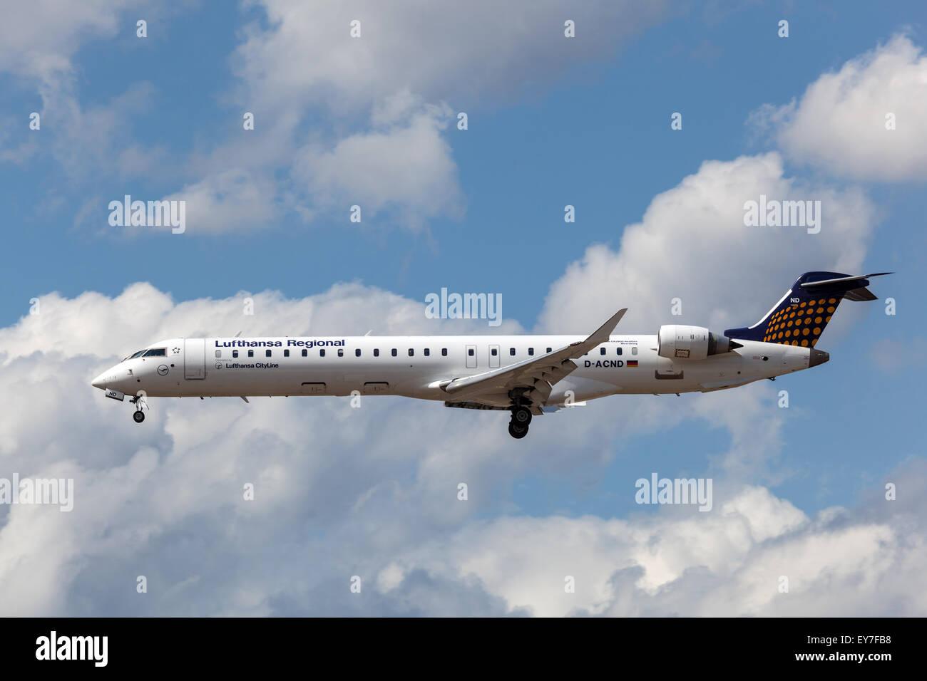 Lufthansa Regional Bombardier CRJ900 NextGen landing at the Frankfurt International Airport - Stock Image