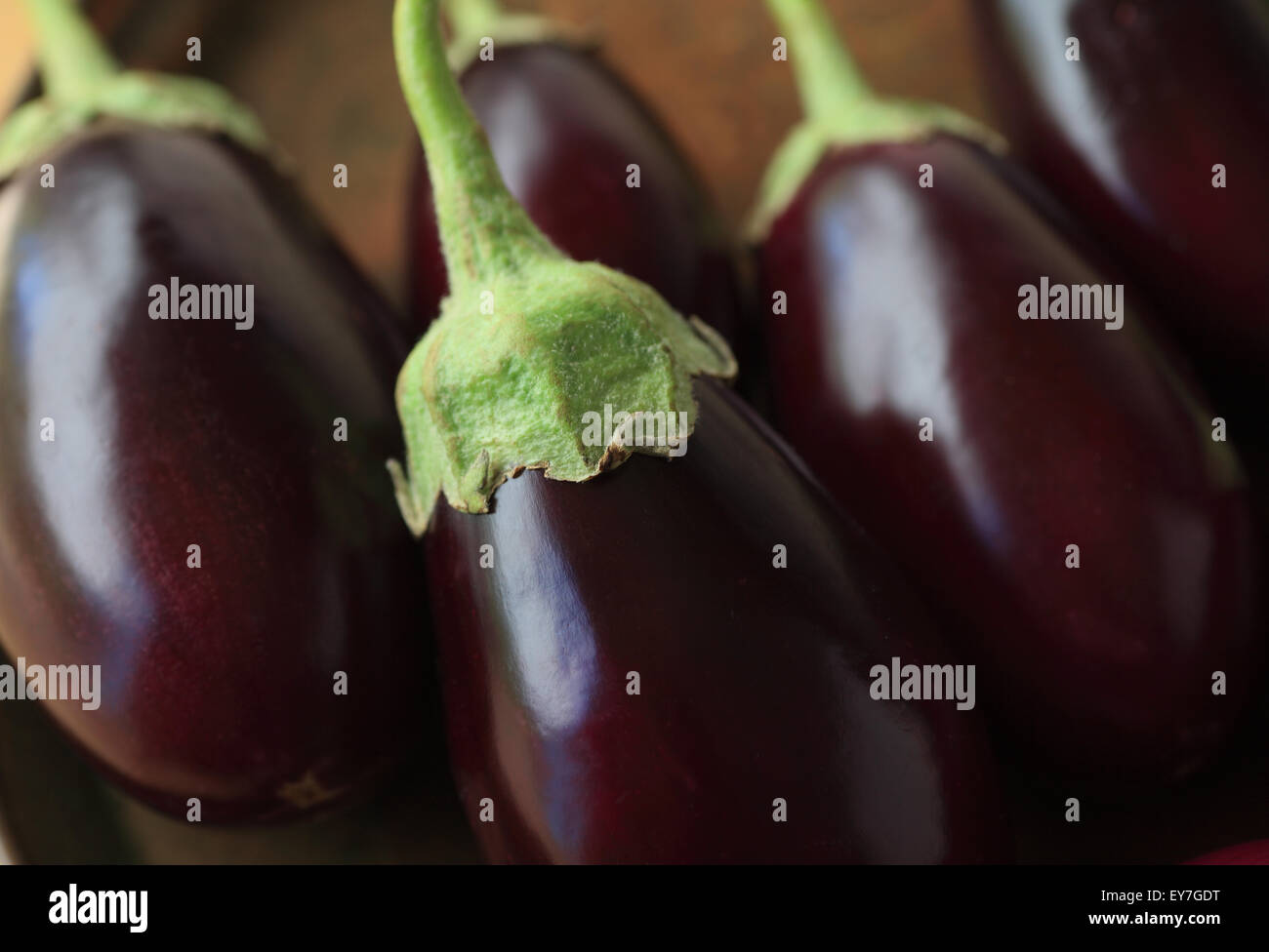 A grouping of fresh eggplants close up - Stock Image