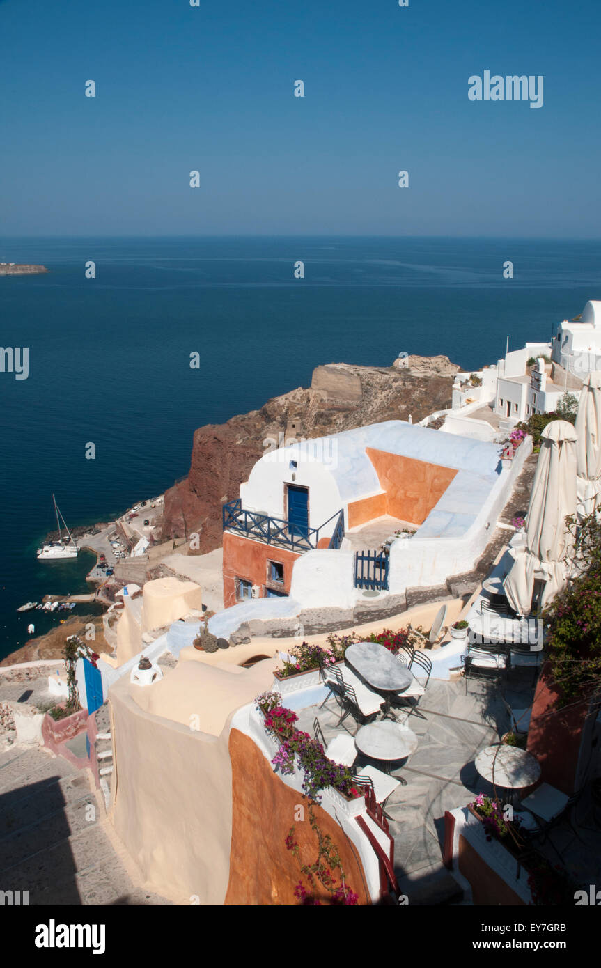 Santorini Island in the Aegean Sea is a part of a caldera topped by white villages on the steep cliffs. - Stock Image
