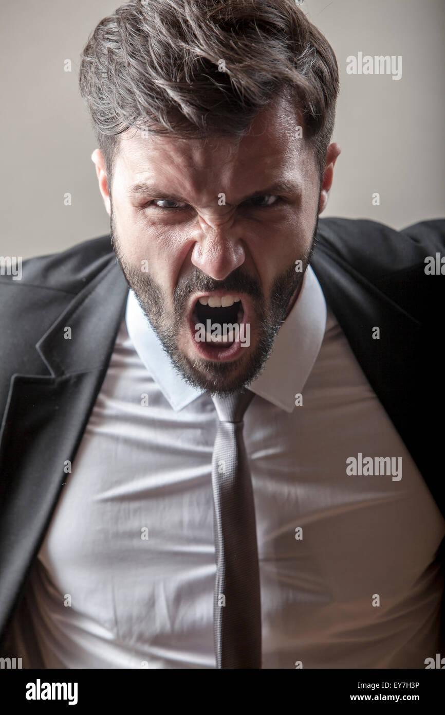 Portrait of businessman screaming - Stock Image