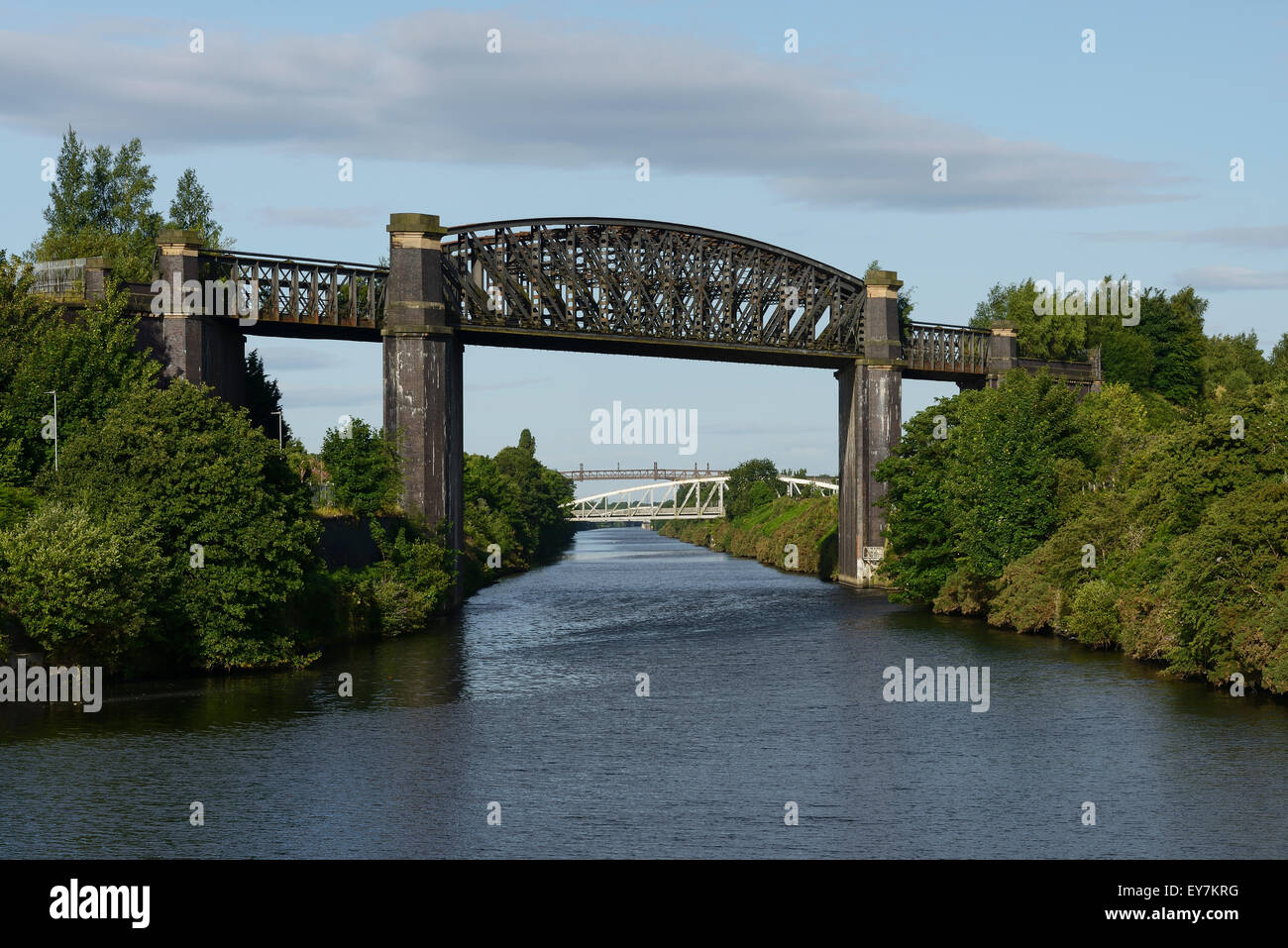 The disused Latchford Railway Viaduct crossing the Manchester Ship Canal in Latchford Warrington UK - Stock Image