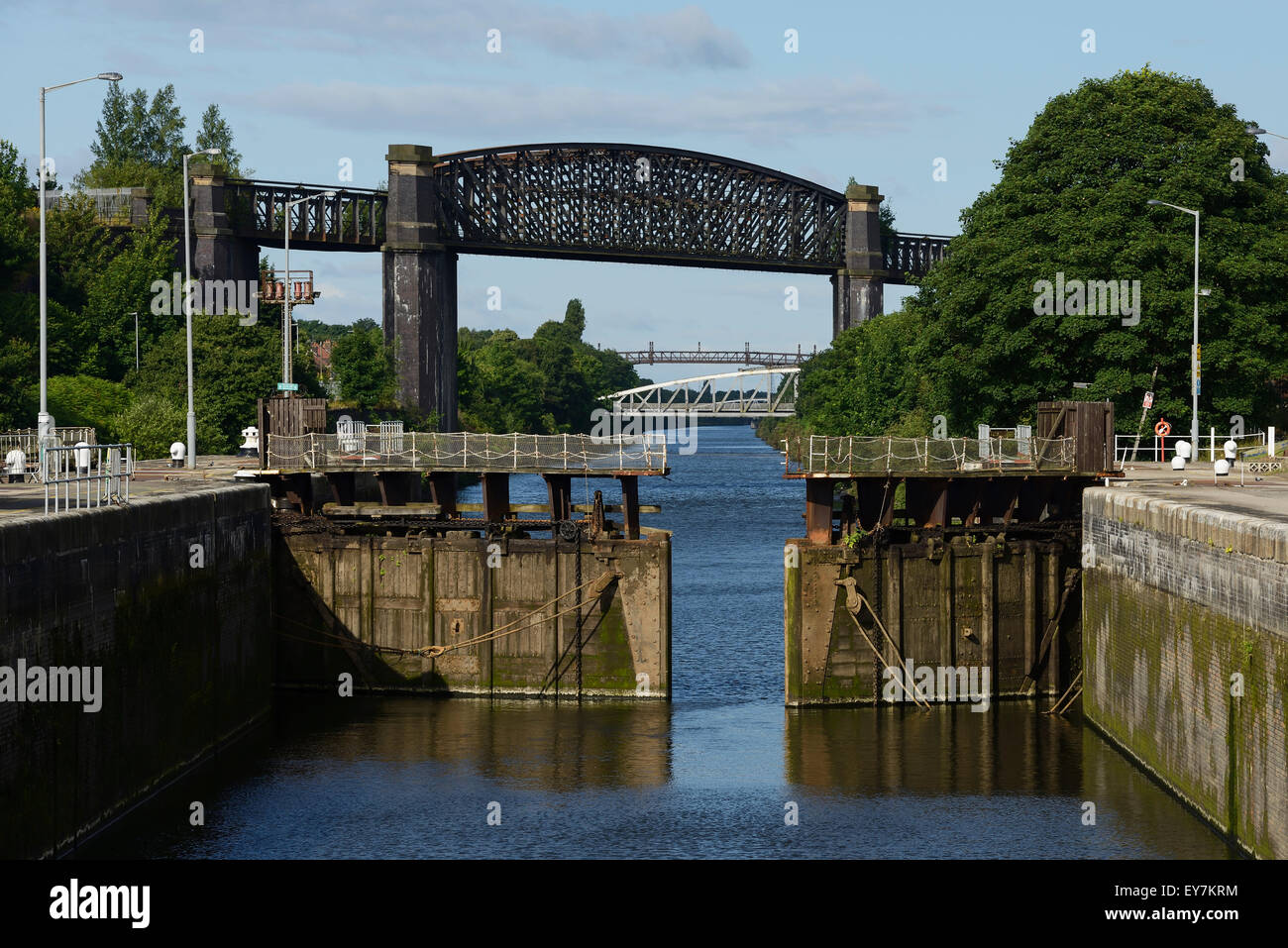 Latchford Locks and the disused Latchford Railway Viaduct crossing the Manchester Ship Canal in Latchford Warrington - Stock Image