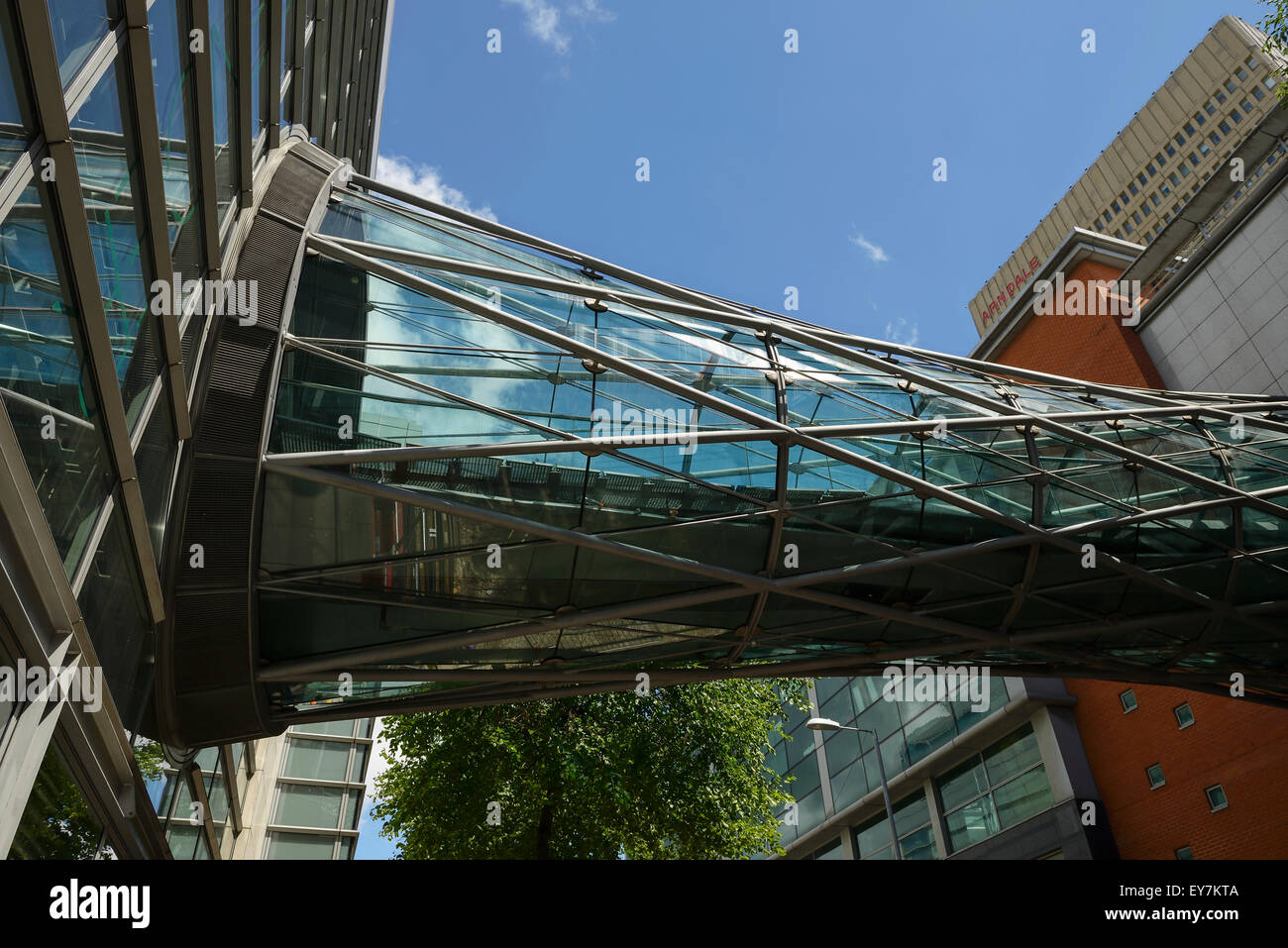 The glass footbridge over Corporation Street in Manchester that connects the Arndale shopping precinct to Marks - Stock Image