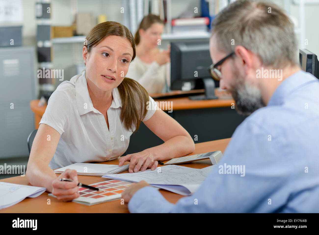 Explaing choices to client - Stock Image