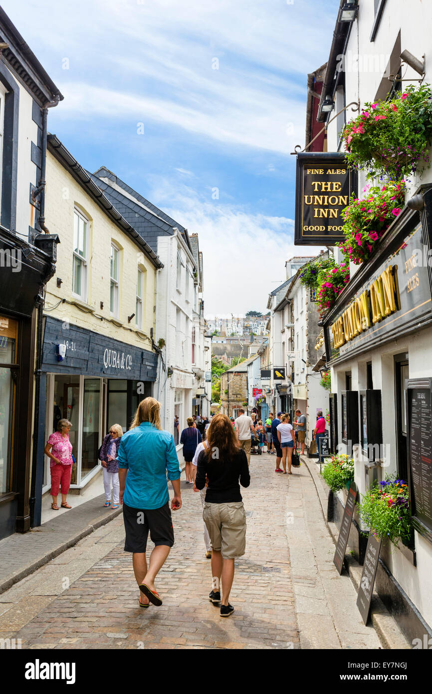 Shops on Fore Street in the town centre, St Ives, Cornwall, England, UK - Stock Image