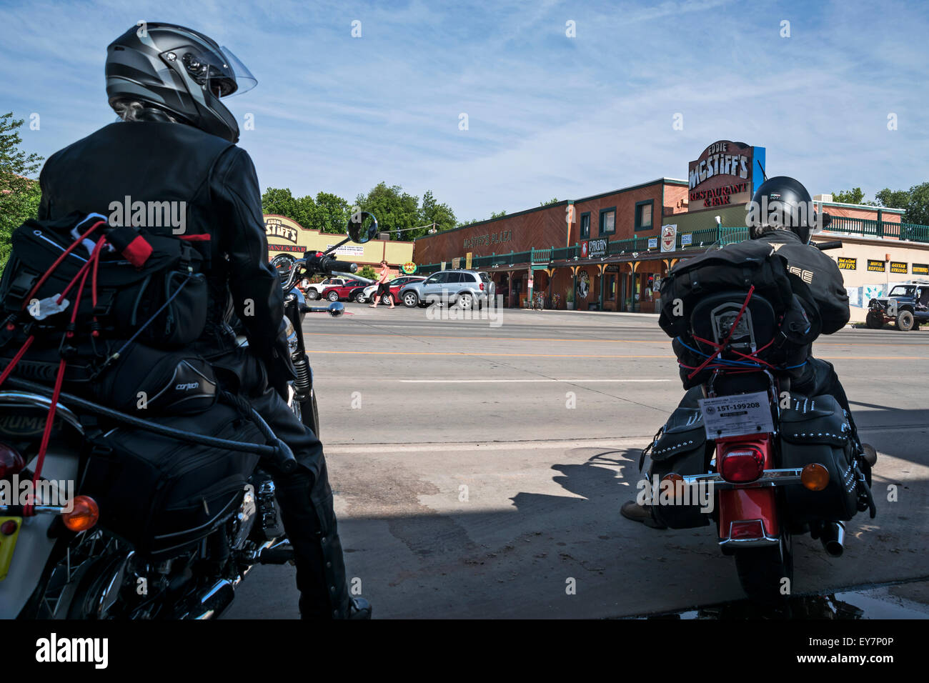 Tourists on a motorcycle on the street of  city Moab, Utah,  USA, North America,United States - Stock Image