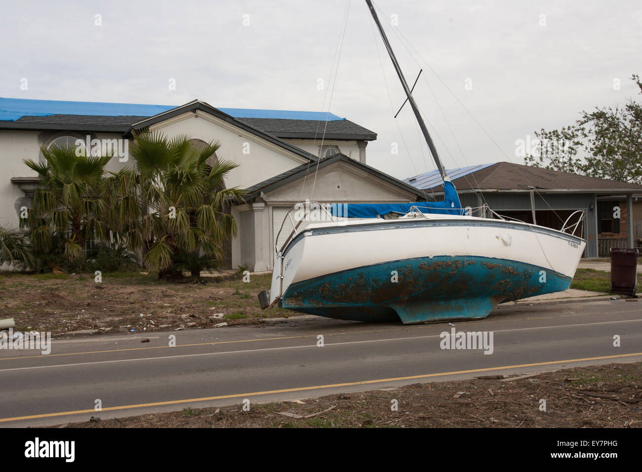 A sailboat on the street in front of a house in Slidell, Louisiana in the aftermath of Hurricane Katrina. - Stock Image