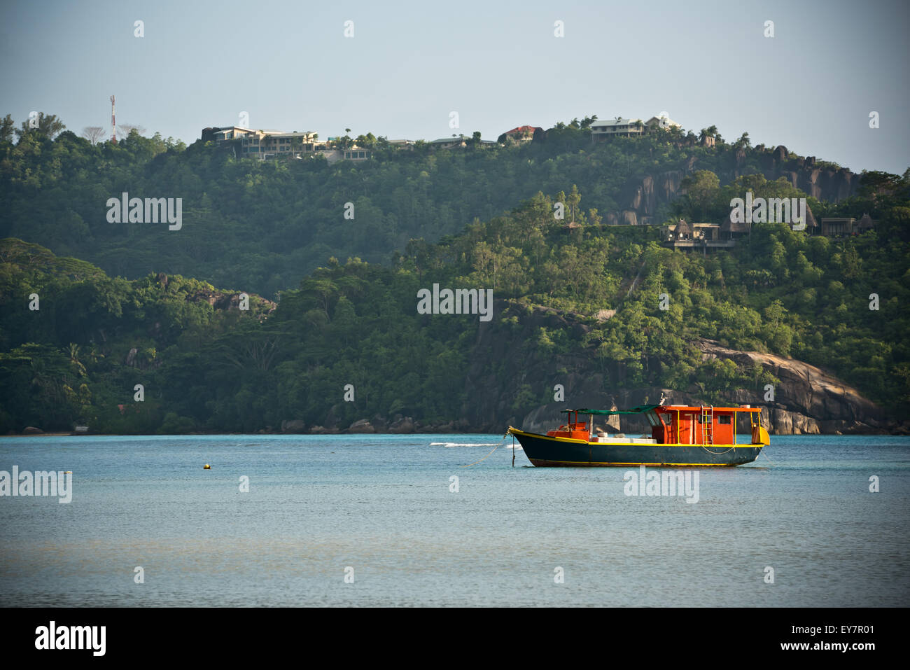 View of Seychelles coastline with a boat on a foreground. Horizontal shot - Stock Image