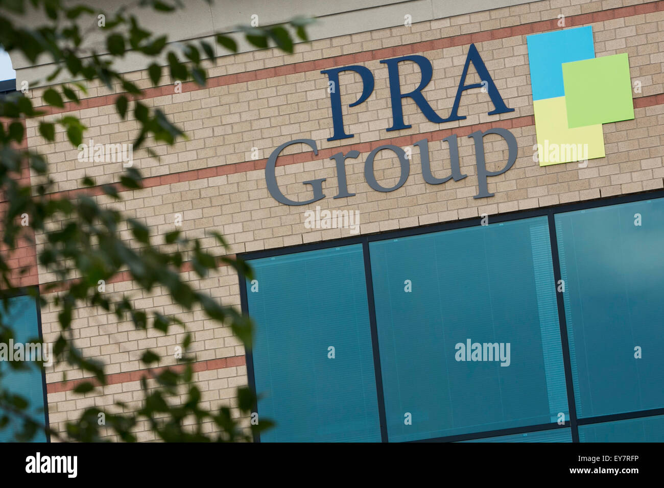 A logo sign outside of the headquarters of the PRA Group, Inc., also known as Portfolio Recovery Associates, in - Stock Image