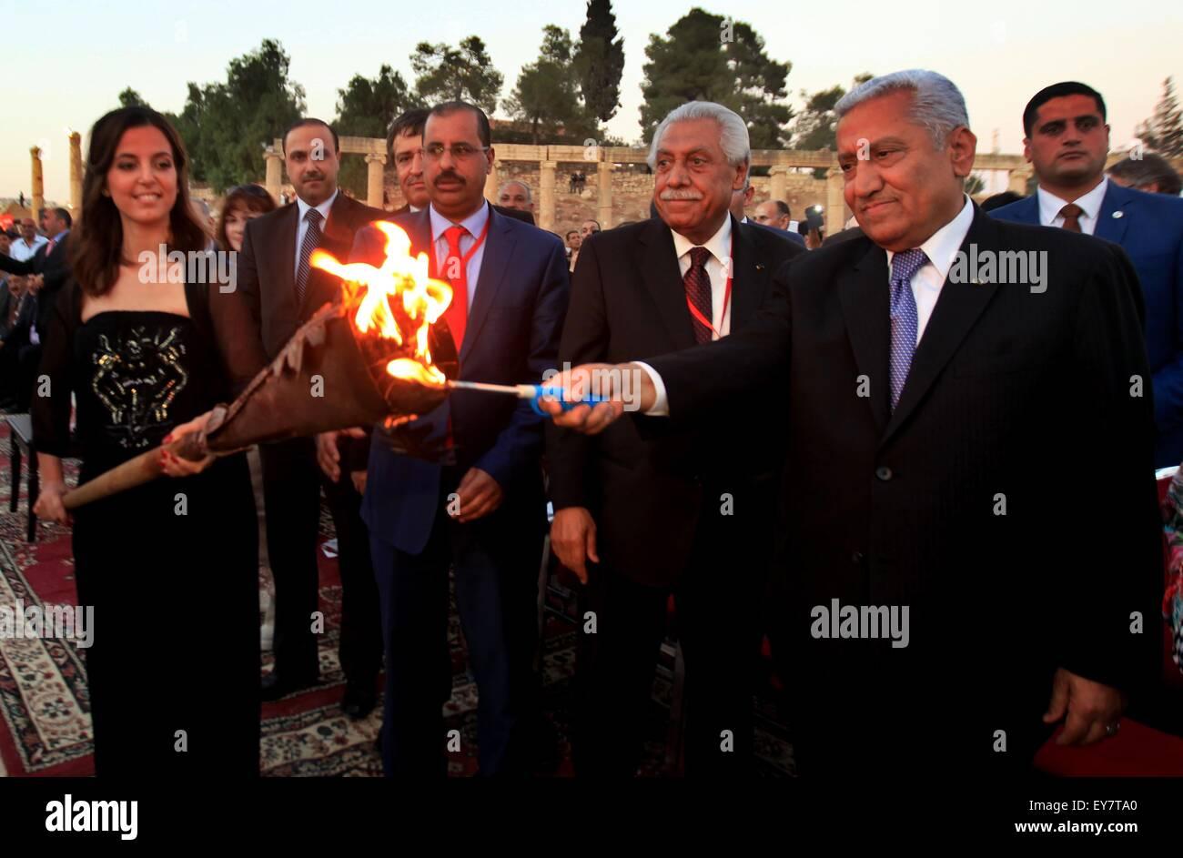 Amman, Jordan. 23rd July, 2015. Jordanian Prime Minister Abdullah Ensour(1st R) ignites the torch of the Jordan's - Stock Image