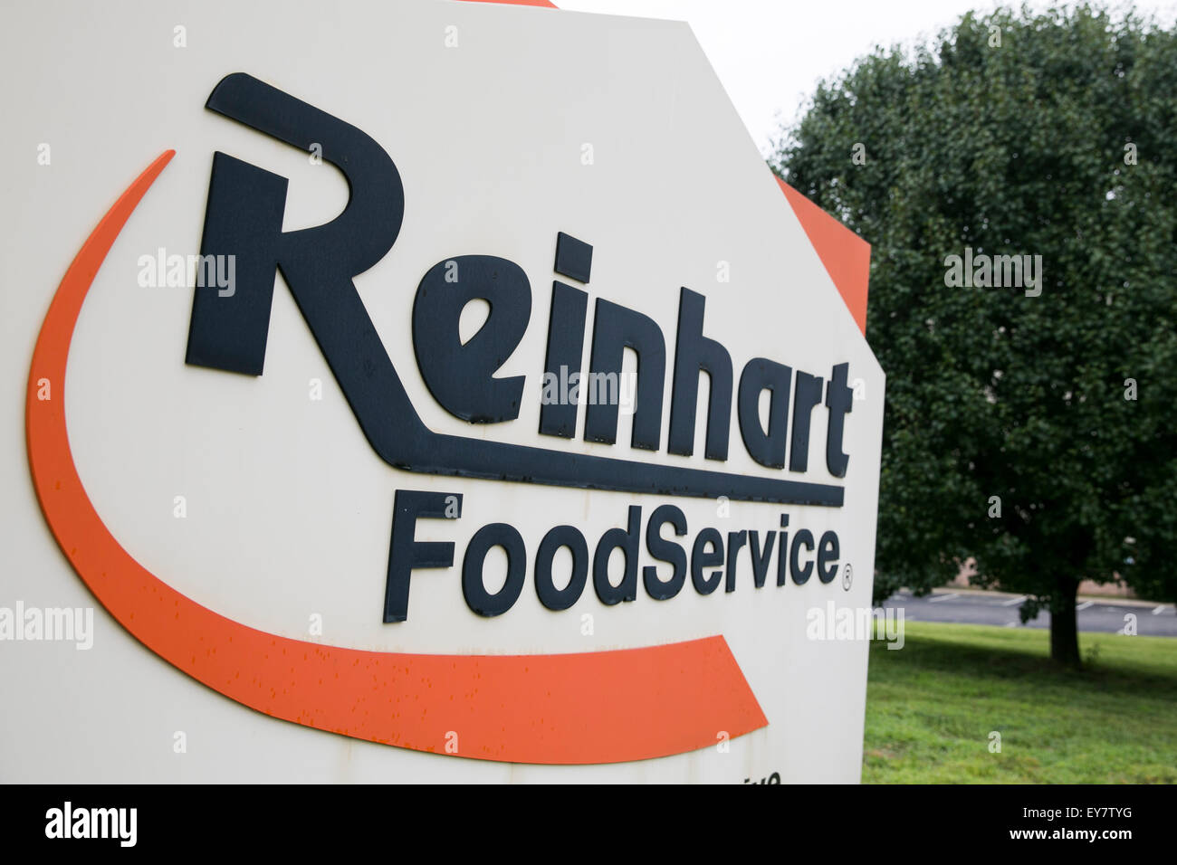 A logo sign outside of a facility occupied by Reinhart Foodservice, LLC, a subsidiary of Reyes Holdings, LLC, in - Stock Image