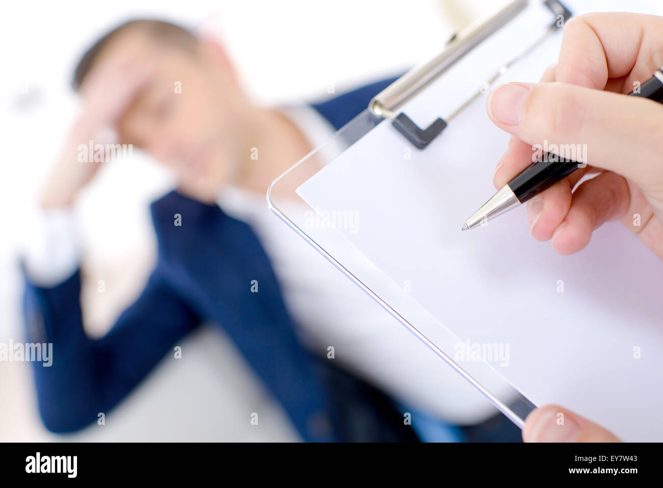 Man behind clipboard - Stock Image