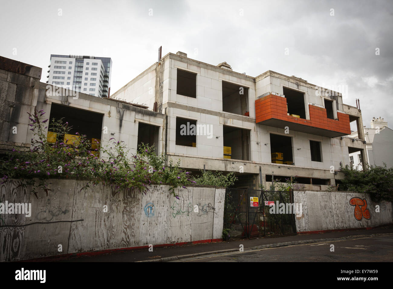 Abandoned building project that has been derelict for years after construction stopped during the recession - Stock Image