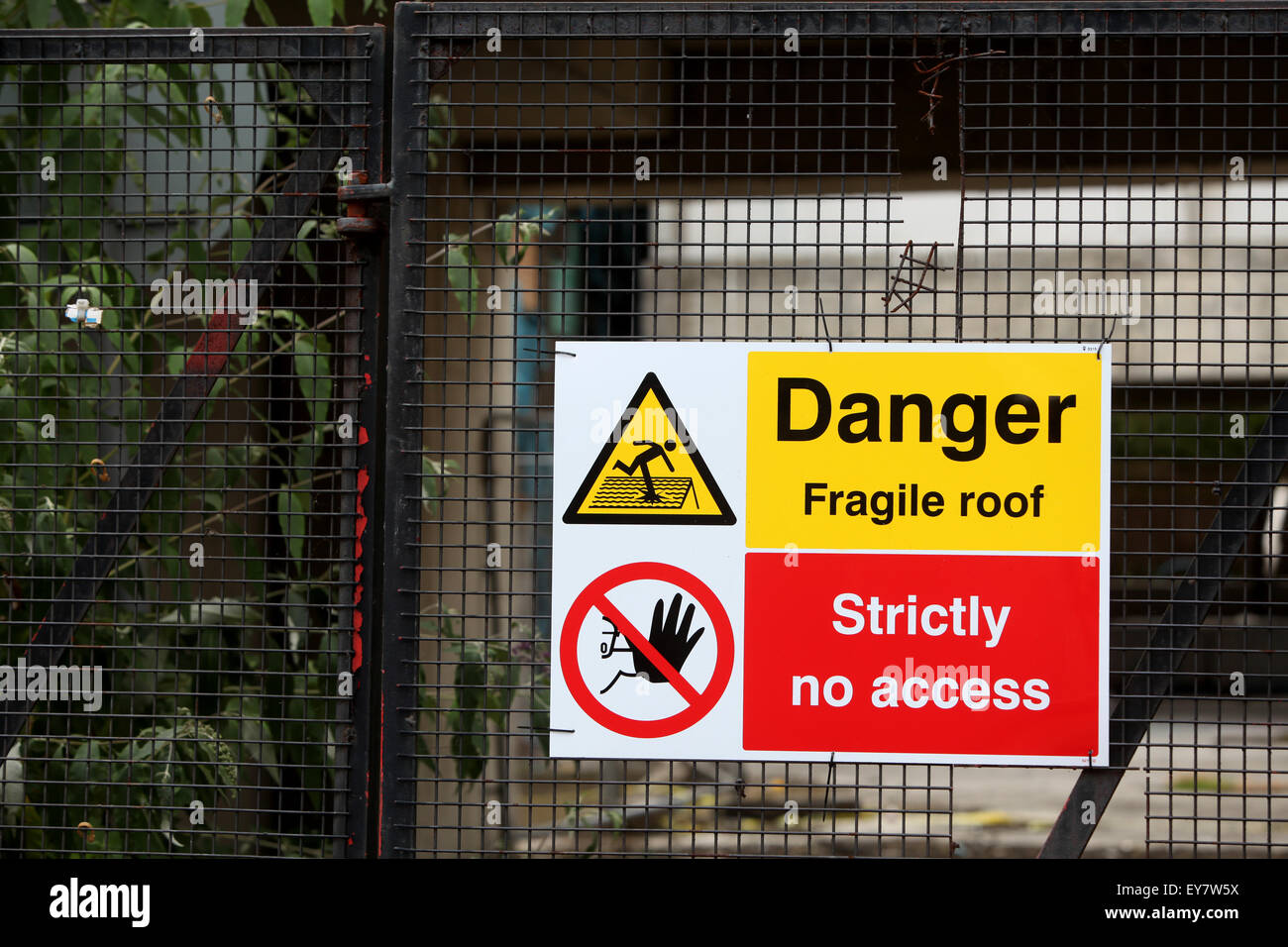 Building site safety signs Danger fragile roof strictly no access - Stock Image