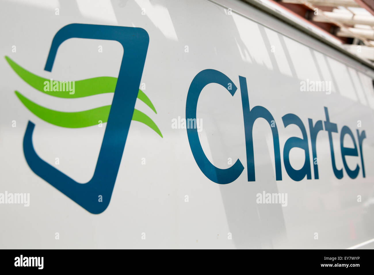 A Charter logo on a cable TV installation van belonging to Charter Communications, Inc. in Onancock, Virginia on - Stock Image