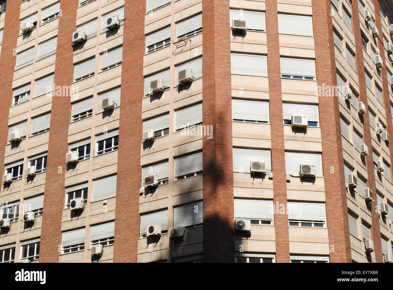 A tower block with several air conditioners on a hot summer day in Zaragoza, Spain. Stock Photo