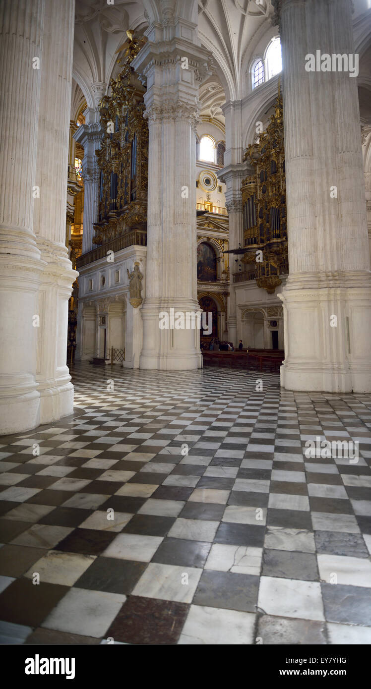 Square tiles white pillars and two organs at the entrance to the Granada Cathedral of the Incarnation - Stock Image