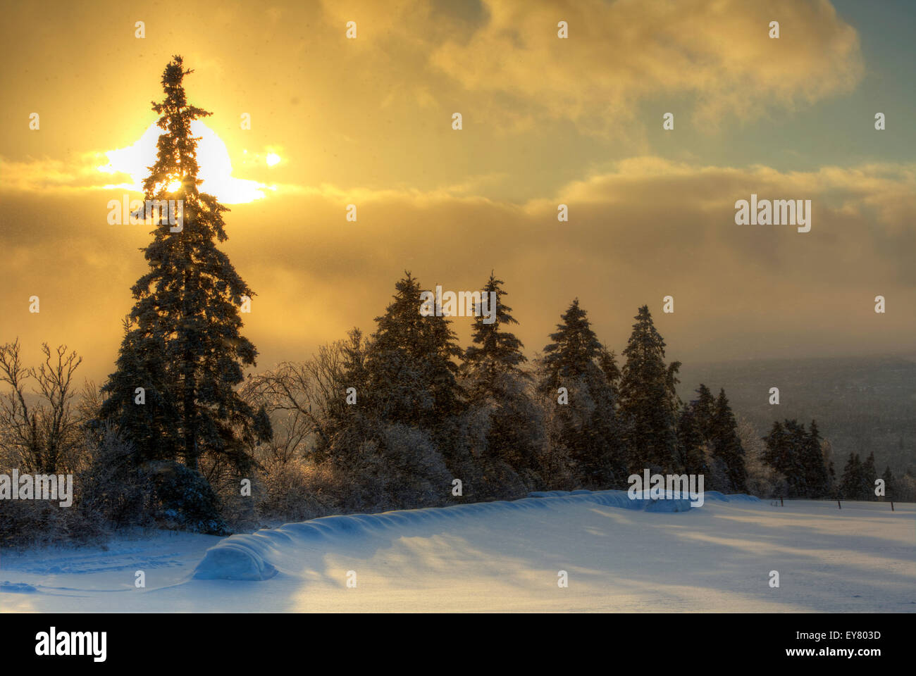 HDR image of a late afternoon sun and snow shower in New Brunswick, Canada. - Stock Image