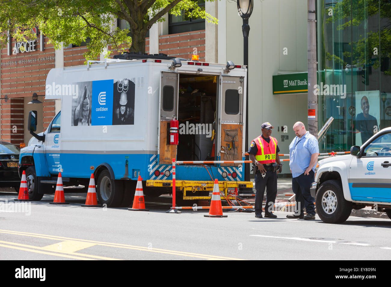 A Con Edison maintenance and repair truck on a street in White Plains, New York. - Stock Image