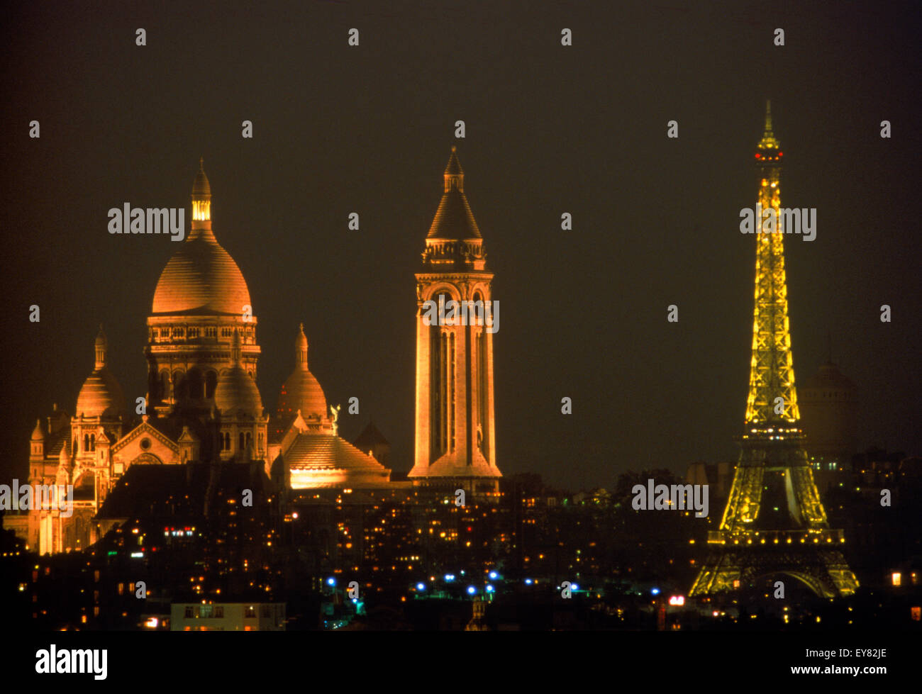 Sacre-Coeur and Eiffel Tower above Paris skyline at night Stock Photo