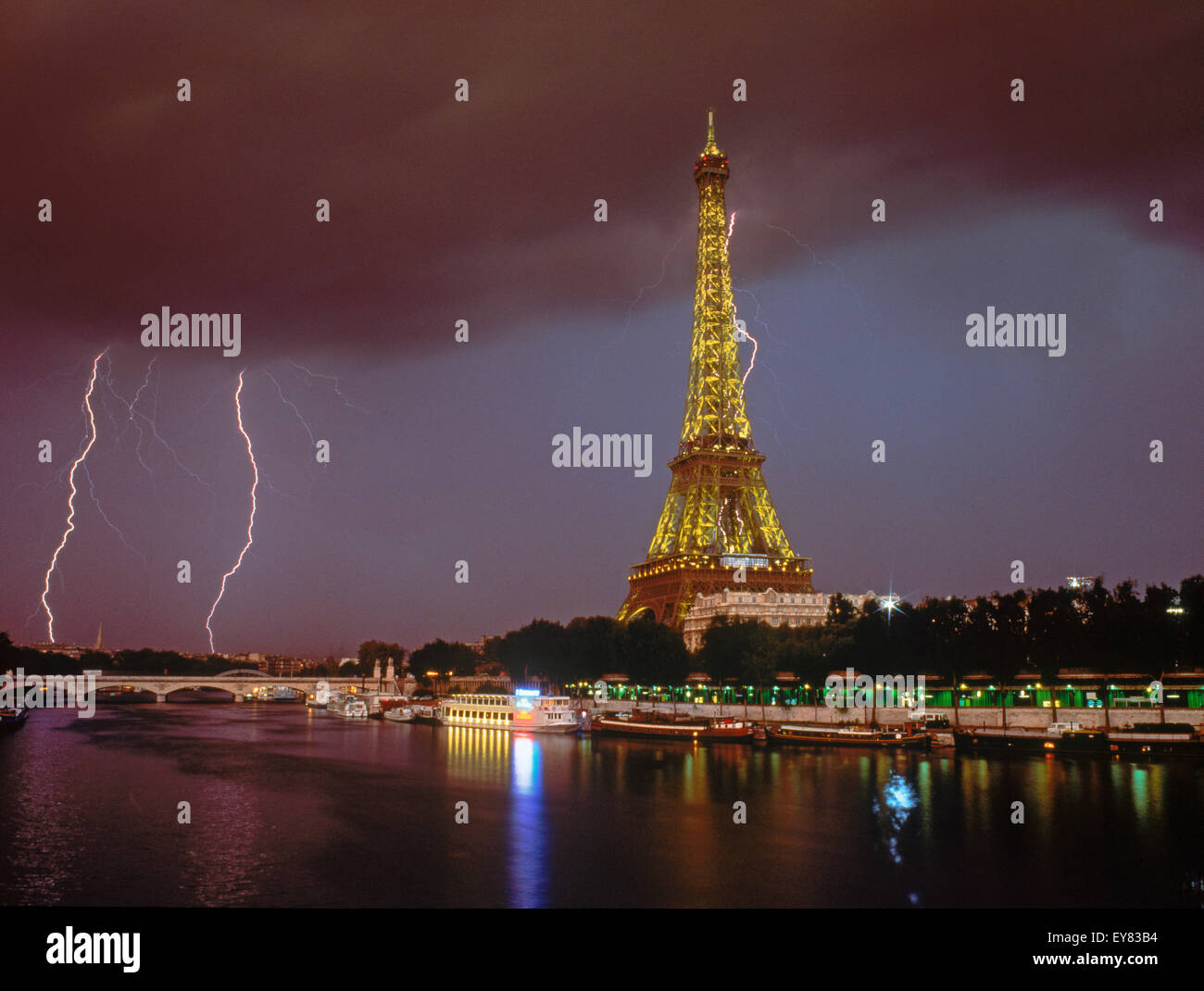 Lightning bolt and storm over Paris at night with Eiffel Tower and River Seine.  This image is not digitally enhanced. - Stock Image