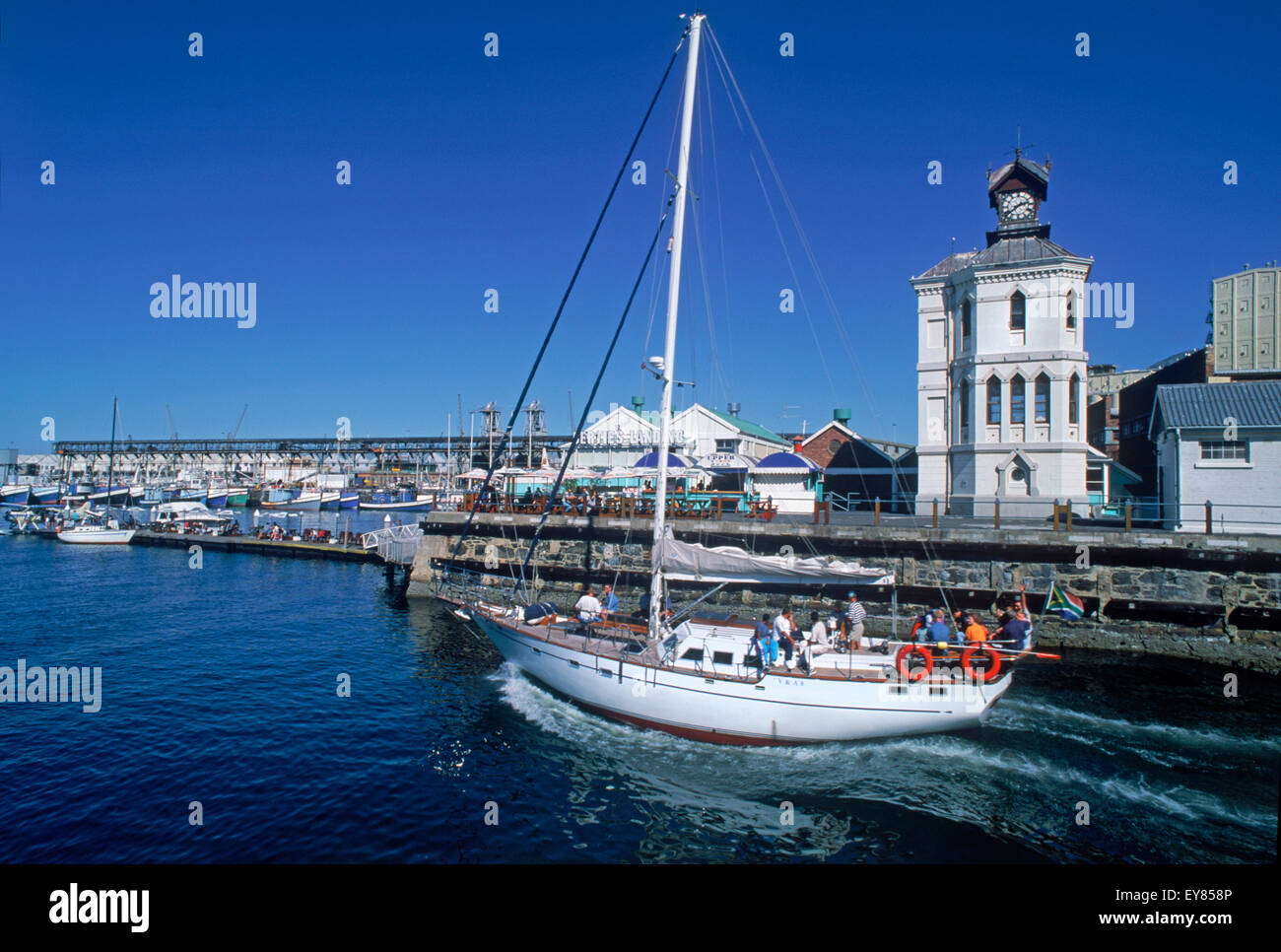 Sailboat leaving Victoria Basin in Cape Town, South Africa - Stock Image