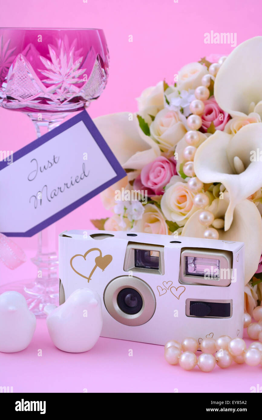 Pink Theme Wedding Table Place Setting with Disposable Camera Stock ...