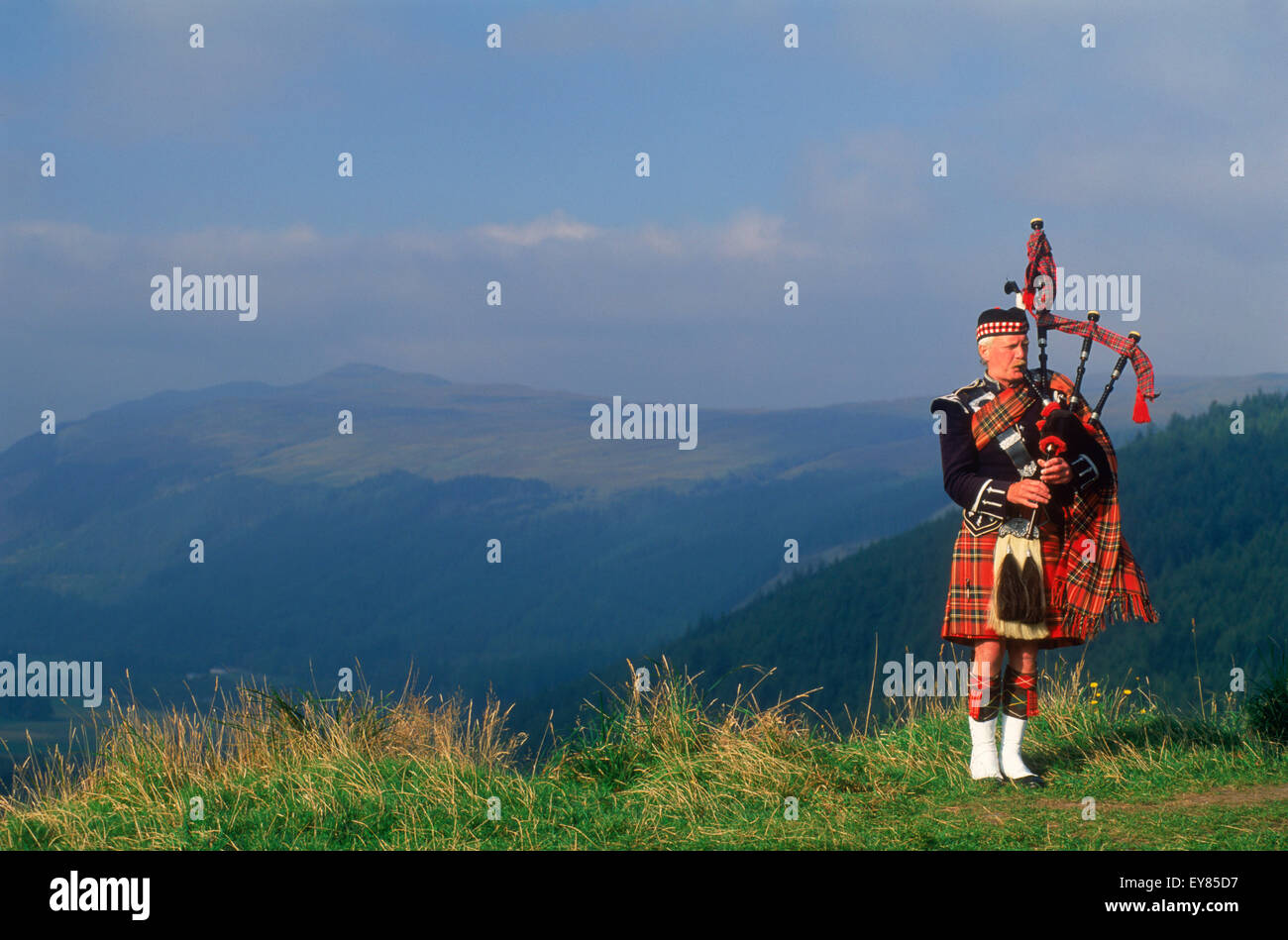 Bagpiper at Loch Broom in Scottish highlands - Stock Image