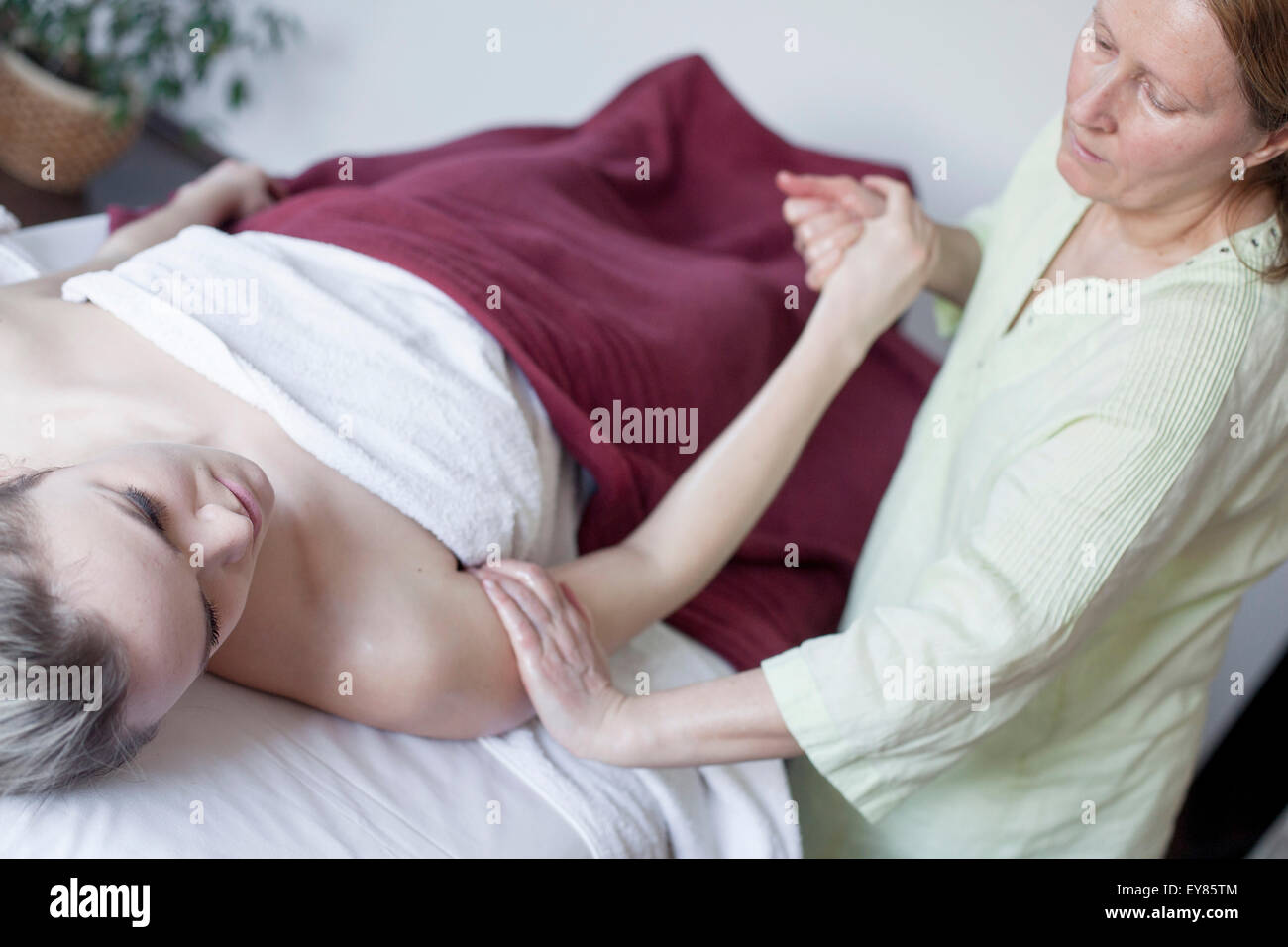 Young woman receiving Shiatsu treatment - Stock Image