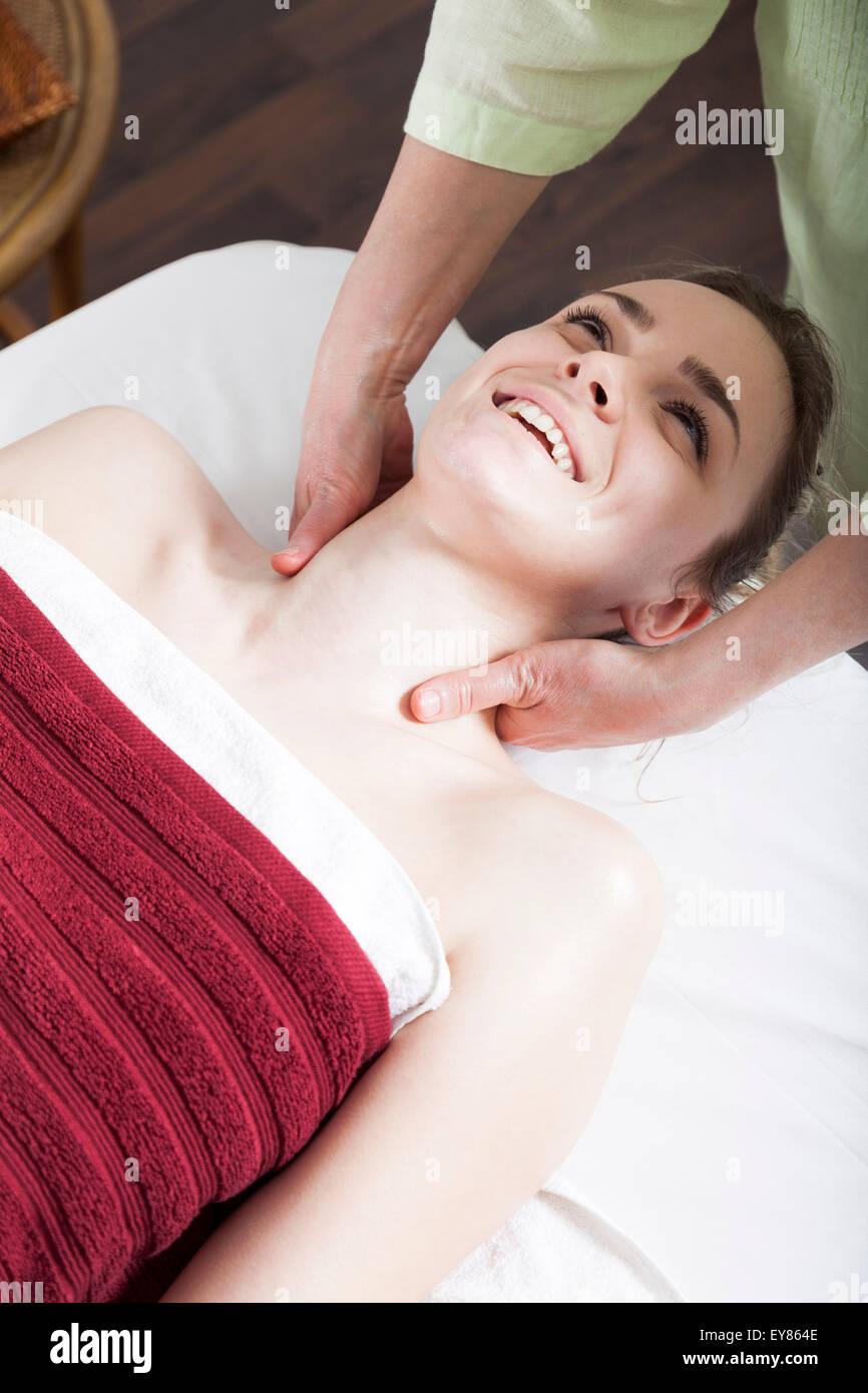 Young woman receiving Shiatsu treatment - Stock Image