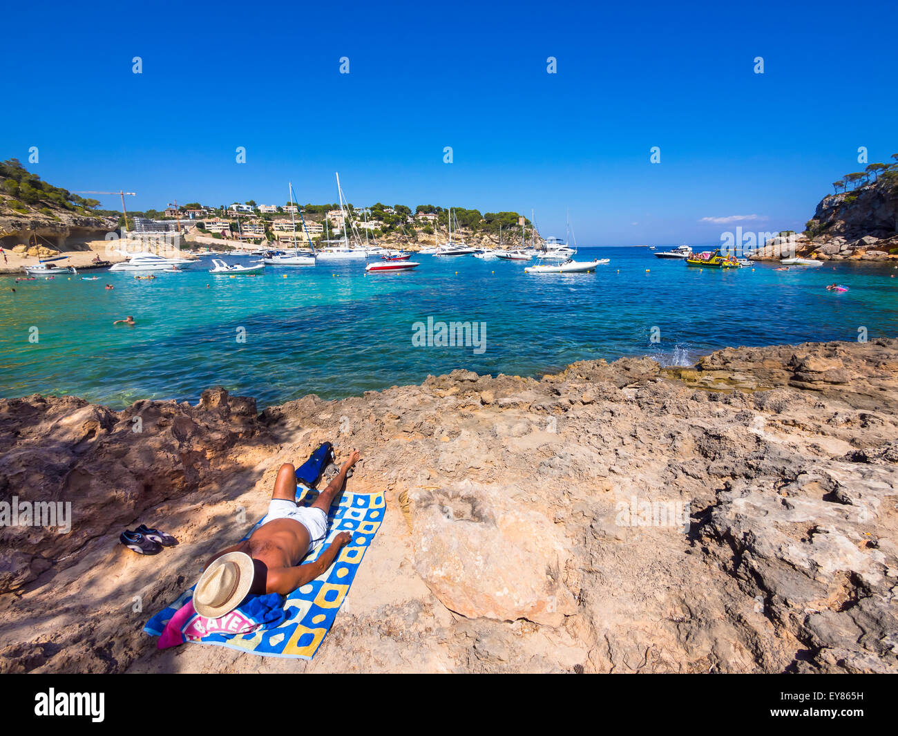 Holidaymaker lying at the bay of Portas Vells, Majorca, Balearic Islands, Spain - Stock Image